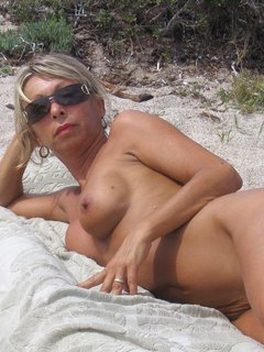 Busty nudist mature woman