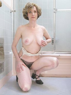 Sexy mature lady with big tits takes a shower