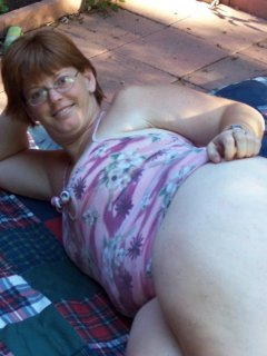 Naughty mature mom playing with her shaved pussy