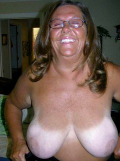 Mature bbw plays with her big tits.