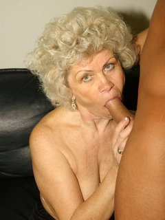 Glamorous mature in stockings sucking cock