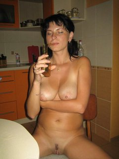 Mature lady smoking ... And...