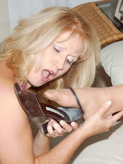 Mature woman loving her dildo