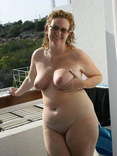 Lovely shaved mature lady with dildo
