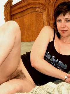 Mature riding a huge dildo!