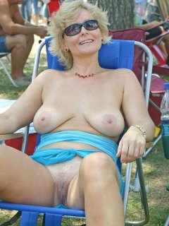Blonde mature in poolcabin