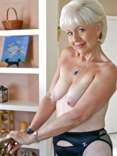 Blackhaired mature with saggy hooters.